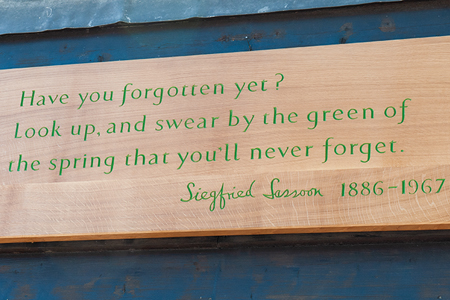 Plaque with Siegfried Sassoon quote carving